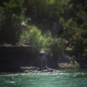 A man chopping up rocks with a hatchet...in his underwear. Albanians can be very entertaining.