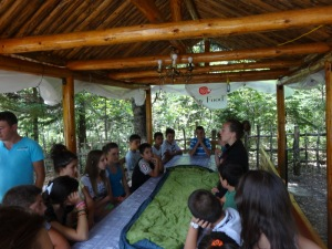 Showing the kids how to use a sleeping bag