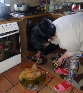 My host mom and the Turkey. Not sure why she put it on the floor.